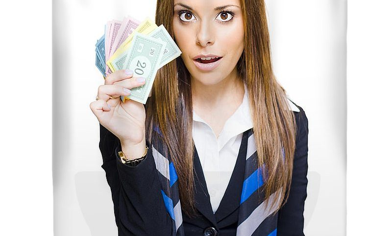1-surprised-young-business-woman-holding-fan-of-money-ryan-jorgensen